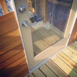 door and cedar siding