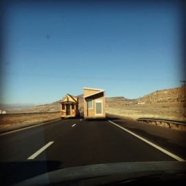 Tiny houses passing on highway
