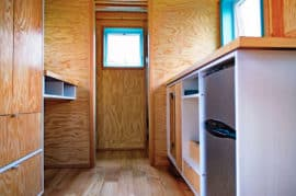 bunk-box-tiny-house-kitchen-closet-desk
